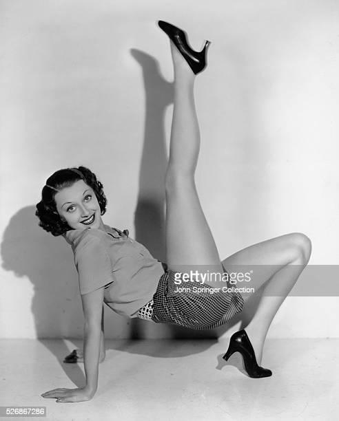 Actress Ann Dvorak Posing Leg in Air