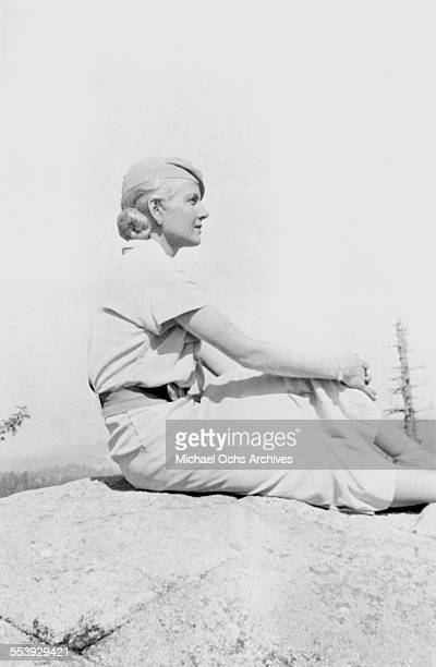 Actress Ann Harding poses on a rock in Los Angeles California