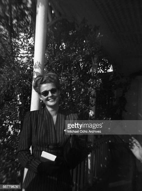 Actress Ann Sheridan poses on a street in Los Angeles California