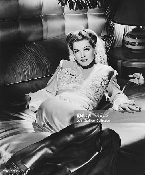 Actress Ann Sheridan Reclining on Sofa