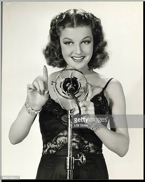 Actress Ann Sheridan sings in the motion picture Broadway Musketeers