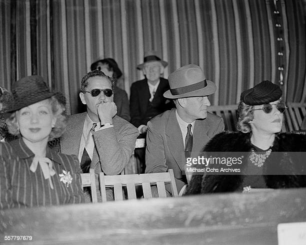 Actress Ann Sothern and her husband Roger Pryor sit with actor Conrad Nagel at an event in Los Angeles California