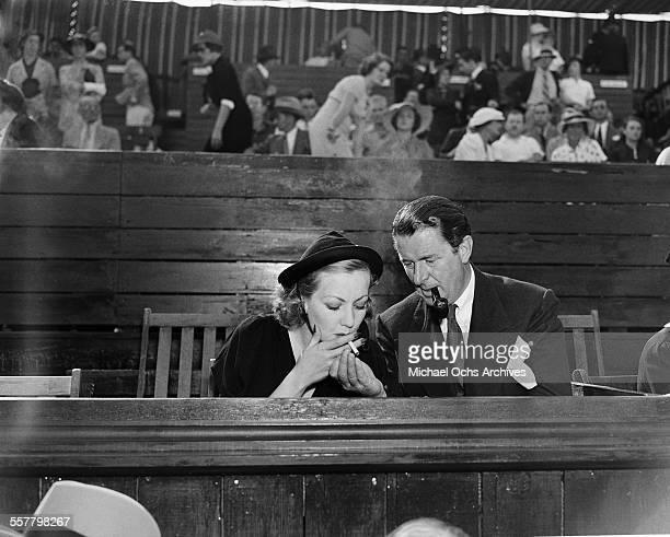 Actress Ann Sothern and Reginald Owen attend a tennis match in Los Angeles California