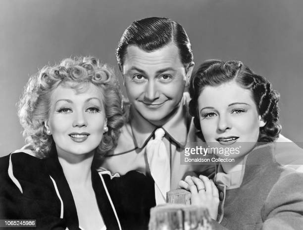 Actress Ann Sothern and Robert Young and Ruth Hussey in a scene from the movie Maisie