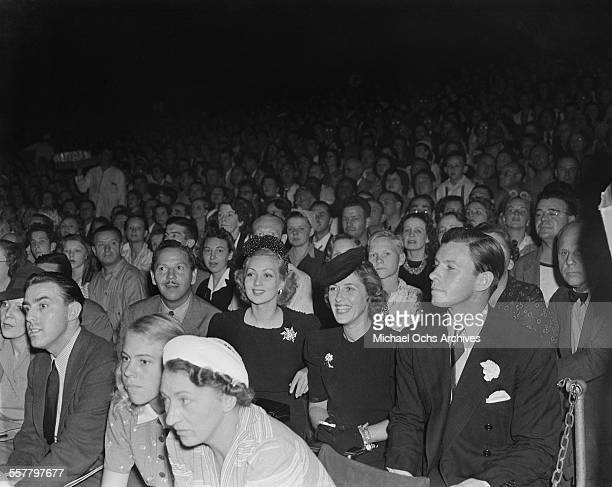 Actress Ann Sothern her husband Roger Pryor and actor George Murphy attend an event in Los Angeles California