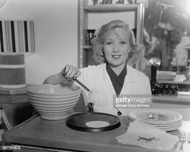 Actress Ann Sothern poses as she makes crepes in Los Angeles California