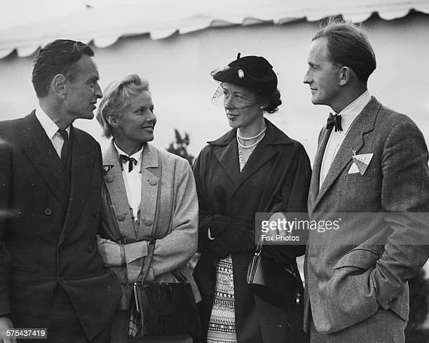 Actress Ann Todd and director David Lean talking to test pilot John Derry the first Briton to exceed the speed of sound and his wife as they talk...