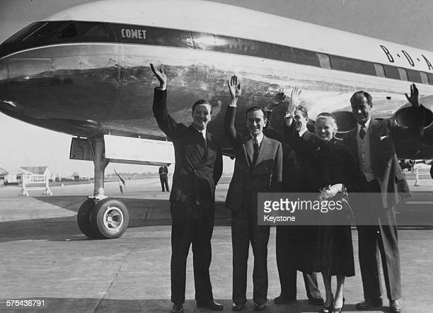 Actress Ann Todd and director David Lean with pilots Mike Lithgow Donald Morgan and Neville Duke all waving after landing in the Comet plane at Orly...