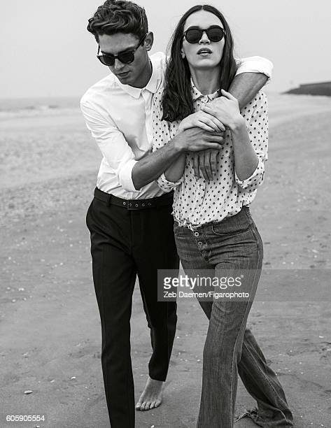 Actress Anna Brewster and model Arthur Gosse are photographed for Madame Figaro on June 24 2016 in Deauville France Arthur Shirt and pants sunglasses...