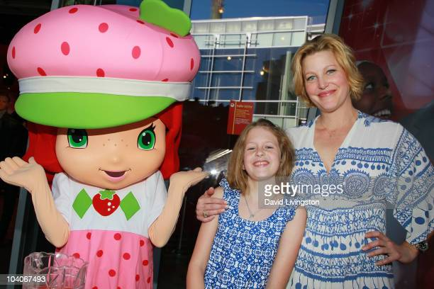 "Actress Anna Gunn and daughter Emma Gunn Duncan pose with ""Strawberry Shortcake"" character at the Alex's Lemonade Stand & Strawberry Shortcake event..."