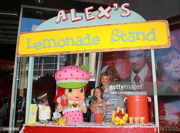 Actress Anna Gunn and daughter Emma Gunn Duncan pose with 'Strawberry Shortcake' character at the Alex's Lemonade Stand Strawberry Shortcake event...