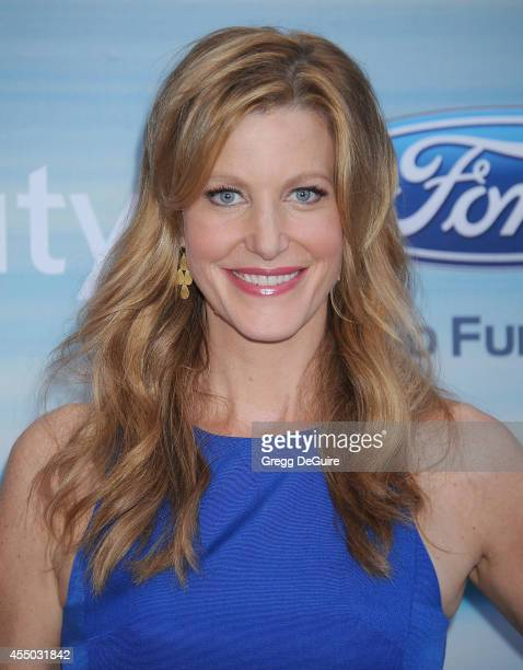 Actress Anna Gunn arrives at the 2014 FOX Fall Eco-Casino Party at The Bungalow on September 8, 2014 in Santa Monica, California.