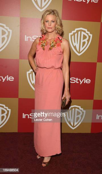 Actress Anna Gunn attends the 2013 InStyle and Warner Bros 70th Annual Golden Globe Awards PostParty held at the Oasis Courtyard in The Beverly...