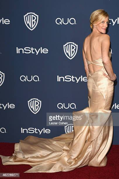 Actress Anna Gunn attends the 2014 InStyle And Warner Bros 71st Annual Golden Globe Awards PostParty held at The Beverly Hilton Hotel on January 12...