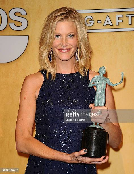 Actress Anna Gunn poses in the press room at the 20th annual Screen Actors Guild Awards at The Shrine Auditorium on January 18 2014 in Los Angeles...