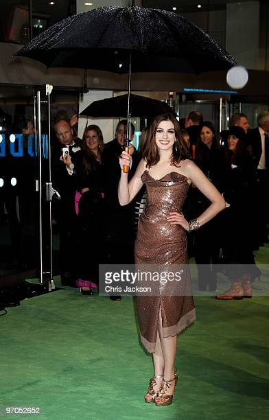 Actress Anna Hathaway shields from the rain with an umbrella as she attends the Royal World Premiere of 'Alice in Wonderland' at the Odeon Leicester...