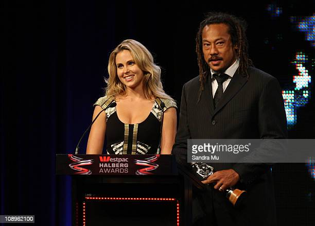Actress Anna Hutchison and Tana Umaga present the Sportsman of the Year trophy during the Westpac Halberg Awards at the SkyCity Convention Centre on...