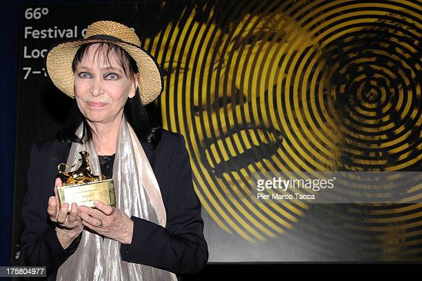 Actress Anna Karina poses with Pardo during the 66th Locarno Film Festival on August 8 2013 in Locarno Switzerland