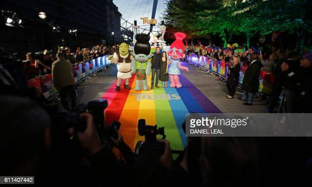 US actress Anna Kendrick and US singer Justin Timberlake pose after arriving to attend the premiere of the film Trolls in central London on September...