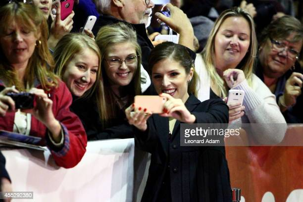 Actress Anna Kendrick poses for a selfie with fans as she attends The Voices premiere during the 2014 Toronto International Film Festival at Ryerson...