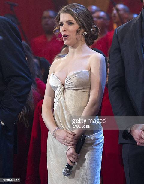 Actress Anna Kendrick sings on stage during a taping of TNT's Christmas in Washington at the National Building Museum in Washington on December 15...