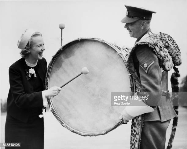 Actress Anna Lee bangs a drum at Aldershot where her new film 'OHMS' is being made UK 17th August 1936