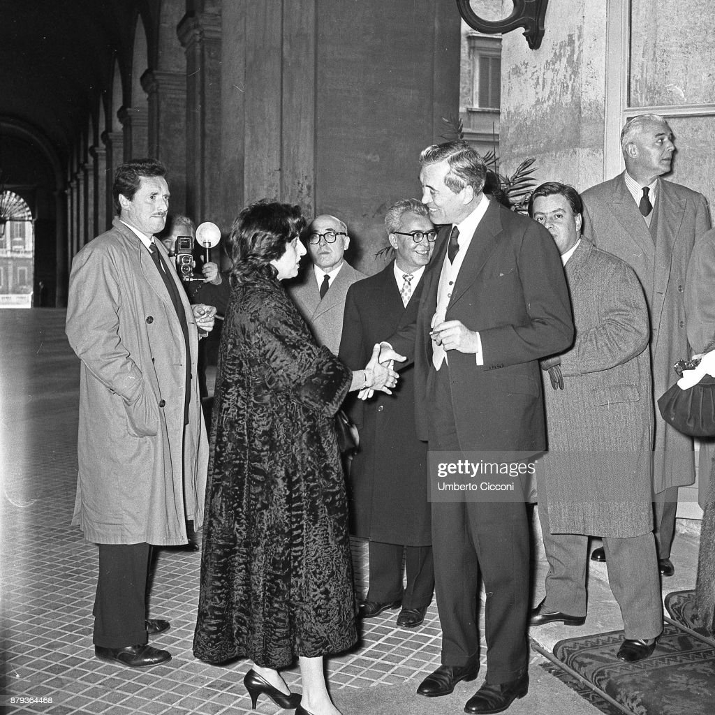 Actress Anna Magnani at the Quirinal Palace with Pietro Germi, Cesare Zavattini, Domenico Meccoli, John Huston and Guidarino Guidi, Rome 1957.