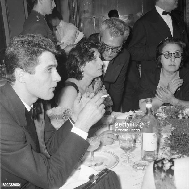 Actress Anna Magnani is with actor Gabriele Tinti and Italian film critic Domenico Meccoli at the 'Grand Hotel Palace' for the Italian film award...