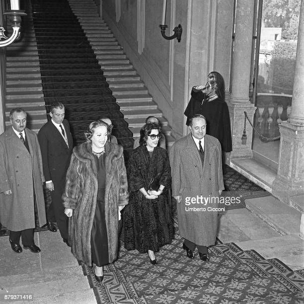 Actress Anna Magnani with actress Marisa Merlini and politician Giuseppe Brusasca at the Quirinal Palace Rome 1957