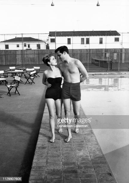 Actress Anna Maria Alberghetti and Buddy Bregman by the pool in 1958