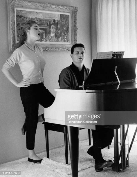 Actress Anna Maria Alberghetti and Buddy Bregmanplay the piano in 1958