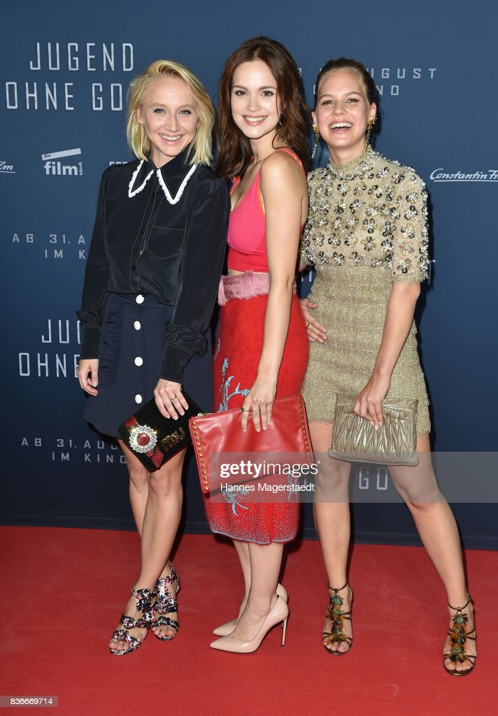 Actress Anna Maria Muehe, Emilia Schuele and Alicia von Rittberg (in Chanel, dress, necklace and handbag) during the 'Jugend ohne Gott' premiere at Mathaeser Filmpalast on August 21, 2017 in Munich, Germany.