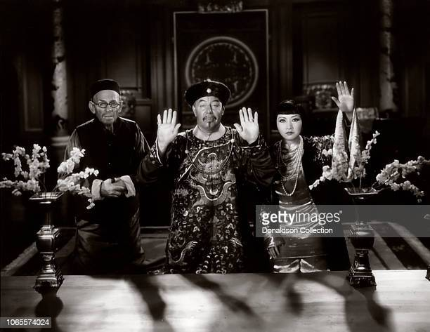 Actress Anna May Wong and E Alyn Warren Warner Oland in a scene from the movie 'Daughter of the Dragon'