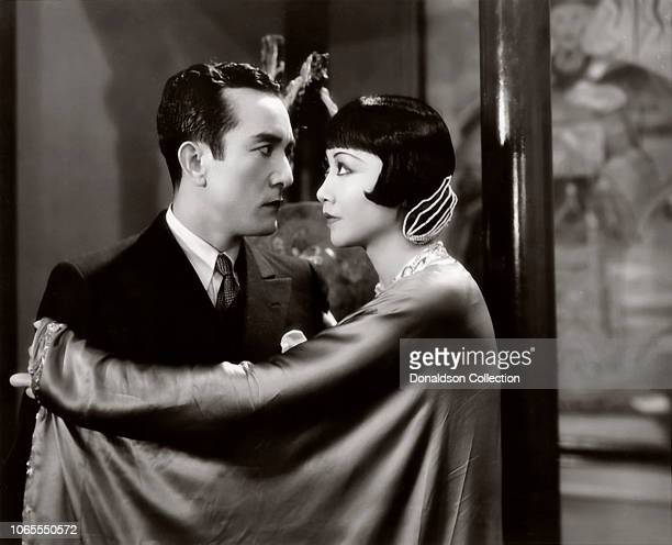 Actress Anna May Wong and Sessue Hayakawa with Harold Minjir in a scene from the movie 'Daughter of the Dragon'