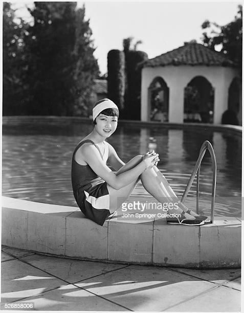 Actress Anna May Wong Sitting by a Pool