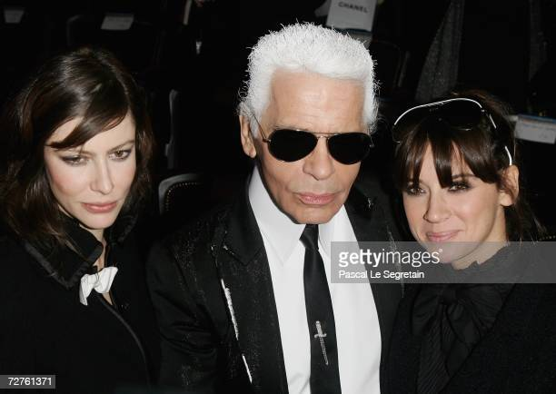 Actress Anna Mouglalis designer Karl Lagerfeld and singer Cat Power pose after the Chanel Paris Monte Carlo Fashion Show on December 7 2006 in Monte...