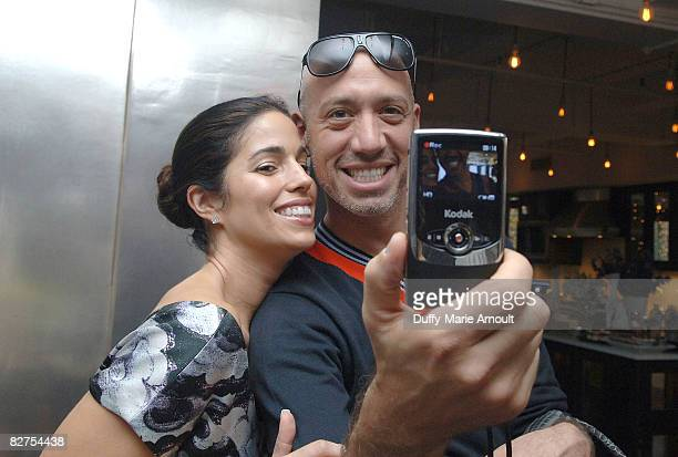 Actress Anna Ortiz and Celebrity Stylist Robert Verdi take a video with the Kodak Zi6 Camera while attending Microsoft's Great American Style at...