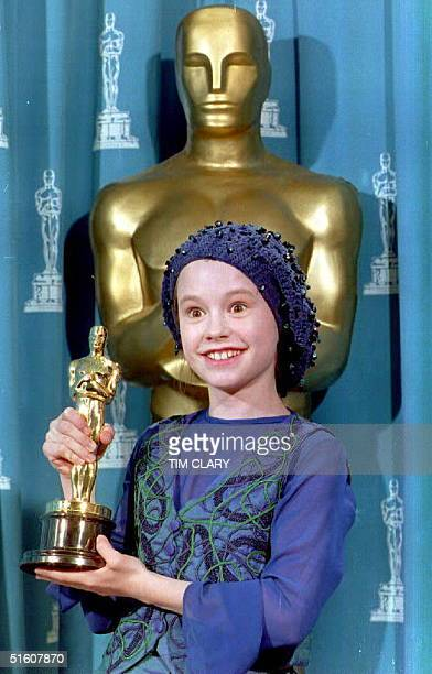 Actress Anna Paquin of New Zealand poses with the 1993 Oscar she received for best supporting actress during the 66th annual Academy Awards 21 March...