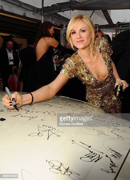 Actress Anna Paquin signs the Chrysler 300 Eco Style car for Stars for a Cause during the 67th annual Golden Globe Awards held at The Beverly Hilton...