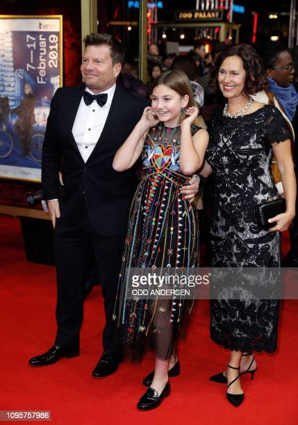 Actress Anna Pniowsky and her parents pose on the red carpet as they arrive for the premiere of the film Light of My Life during the 69th Berlinale...