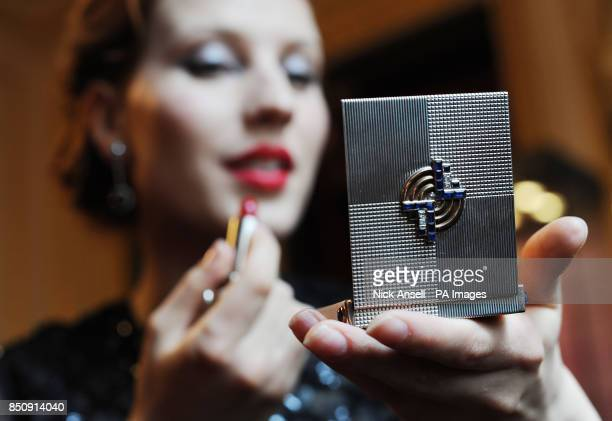Actress Anna Swan uses a bejewelled Art Deco compact by Chaumet circa 1925 on show as part of the Ultra Vanities Bejewelled makeup boxes from the Age...
