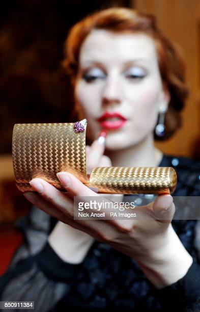 Actress Anna Swan uses a bejewelled necessaire by Faraone circa 1940on show as part of the Ultra Vanities Bejewelled makeup boxes from the Age of...