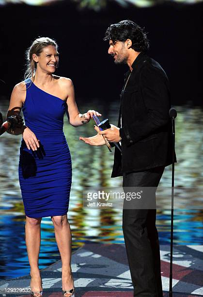 Actress Anna Torv and actor Joe Manganiello onstage during Spike TV's Scream 2011 at Universal Studios on October 15 2011 in Universal City California