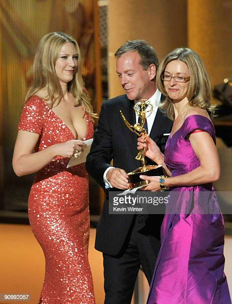 Actress Anna Torv and actor Kiefer Sutherland present the Outstanding Made For Television Movie award to Anne Pivcevic Producer onstage during the...