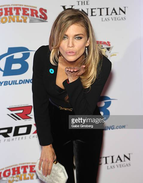 Actress AnnaLynne McCord blows a kiss as she arrives at the seventh annual Fighters Only World Mixed Martial Arts Awards at The Palazzo Las Vegas on...