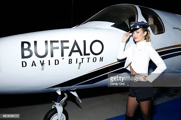 Actress AnnaLynne McCord hangs out at Buffalo David Bitton's jet at the Maxim Party on January 31 2015 in Phoenix Arizona