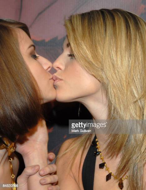 Actress AnnaLynne McCord right kisses her sister at the launch party for 'Afro Samurai' for Xbox 360 and Playstation 3 at the Geisha House on January...