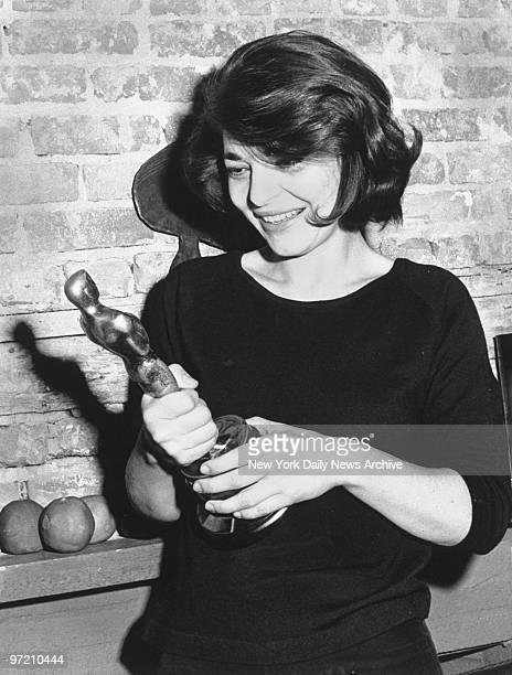 Actress Anne Bancroft clutches Oscar she won for performance in The Miracle Worker
