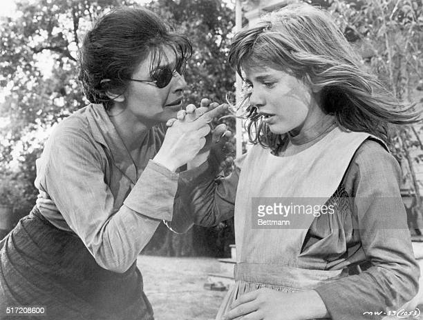 Actress Anne Bancroft playing educator Annie Sullivan pleads with actress Patty Duke playing Helen Keller in the 1962 production of The Miracle...