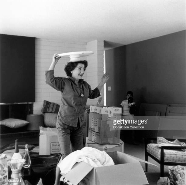 Actress Anne Baxter and her daughter Katrina Hodiak unpacking their home in 1955